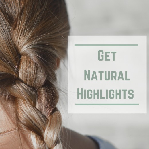 Use lemon juice or chamomile tea and sunshine for natural, blonde highlights or streaks.