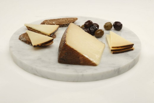 """Manchego has a nutty, buttery flavor and a is considered a """"hard"""" variety of cheese. (BH)"""