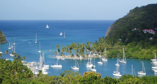 St. Lucia is an island with blue skies, blue waters and lush green landscape.