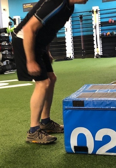 An older person about to jump onto an exercise box.