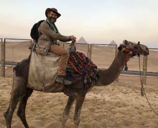 The author preparing for an evening camel ride in the desert