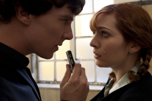 Sherlock being interviewed by a reporter.