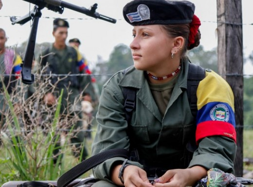 FARC fighter. Look closely at Cuban flag and image of Che Guevara on her beret.