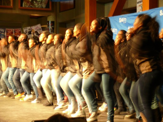 A group of young people singing and dancing at the Annual National Art Festival