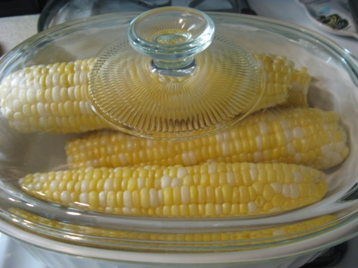 Corn on the cob ready for the microwave.