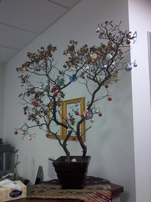This picture (from Morguefile.com) reminds me of the first year of marriage, when we could not afford a tree. I tried to decorate a branch instead.