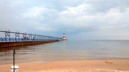A long pier extends out to the lonely St. Joseph Lighthouse.
