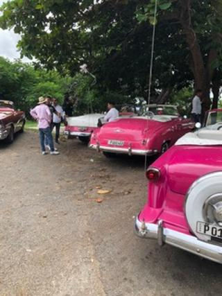 Cuban classic cars. This scene is repeated throughout the city. Love that pink!