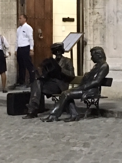 Statues in Plaza de San Franscisco in Havana, Cuba. One is alive. Can you tell which?