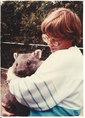 Here I am in Tasmania cuddling a young wombat.