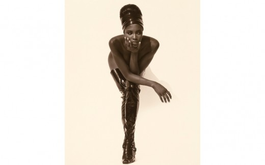 Herb Ritts, Naomi Campbell, Face in Hand, Hollywood, 1990, Gelatin silver print. 19 5/6 x 16 in. The J. Paul Getty Museum, Gift of the Herb Ritts Foundation