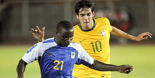 Tanzania's Stafan (#21) battles with Brazil's Kaka (#10) during a friendly match at the National Stadium in Dar Es Salaam on June 7, 2010. The 5-1 Brazil victory proved to be the final match for Marco Maximo as Tanzania's manager.