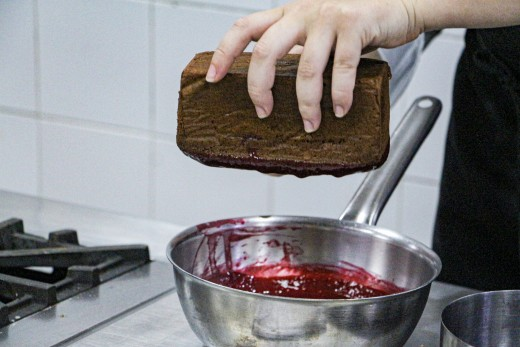 When the cake is firm, dip it into the raspberry confit (Step 10)