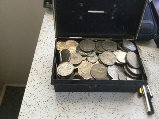 The money box, full to overflowing