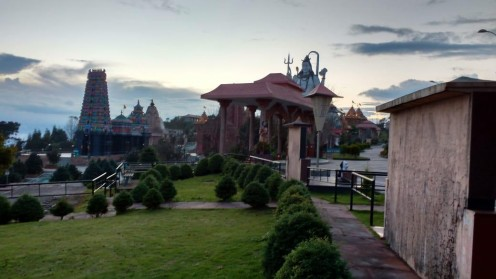 The complex after sunset, lush greenery, the statue of Shiva, a few replicas, and the beautiful color of the sky