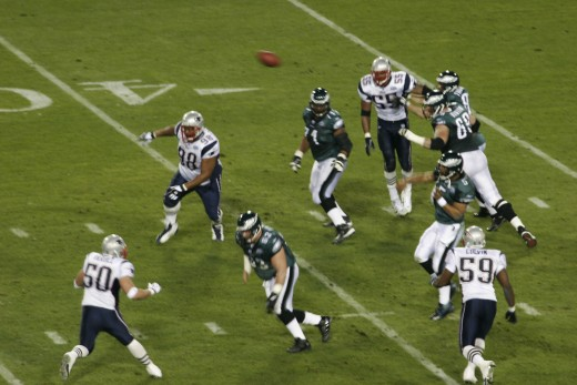 Philadelphia Eagles quarterback Donovan McNabb (No. 5) throwing a pass against the New England Patriots in Super Bowl XXXIX