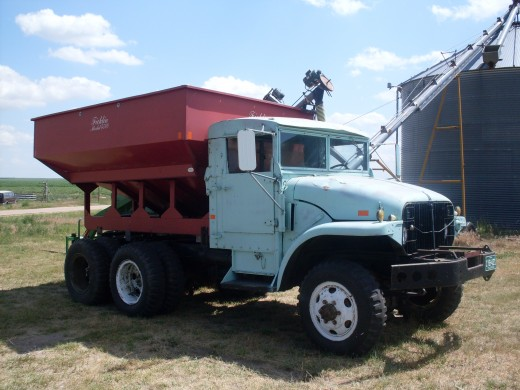 "The main grain truck, a 1952 military truck, fitted with a gravity wagon. We affectionately refer to it as ""The Six-By""...as in, 6X6 military truck."