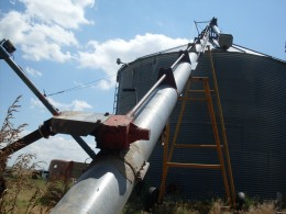 The transport auger, with the upper end positioned over the hole in the grain bin.