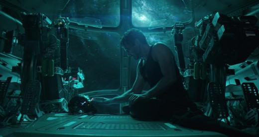 """Tony Start talking to his """"Iron Man"""" helmet."""
