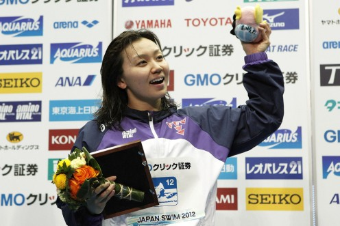 Yuka Kato is excited after winning the Women's 100 meter butterfly event following the Japan Swim 2012 event.