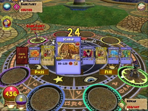 Rowan's cards in a turn-based battle against the dark fairy.