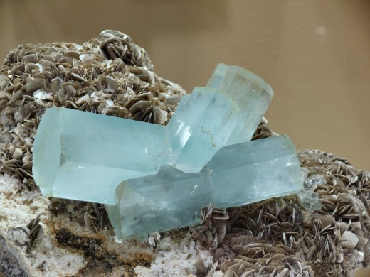 March's birthstone is aquamarine. This aquamarine specimen from Pakistan is perched on a bed of muscovite mica.