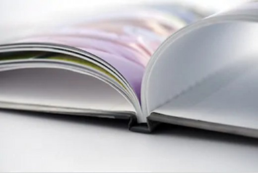 You could take advantage of photo book makers, such as Snapfish.com, or you could create your own books using actual photos.