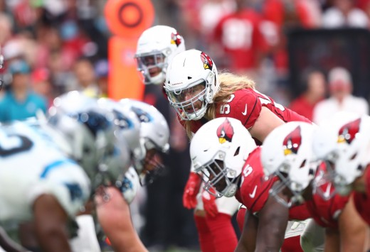 Arizona Cardinals linebacker, Brooks Reed, eyes the Carolina Panthers offensive line during a 2019 game. The Cardinals and Panthers have become rivals after facing off three times in the playoffs since 2008.