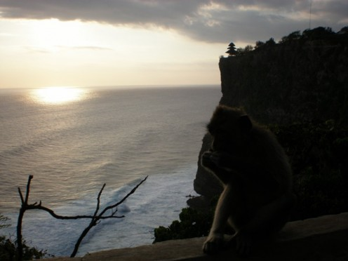 Sunset at Uluwatu, with Uluwatu Temple at the background.