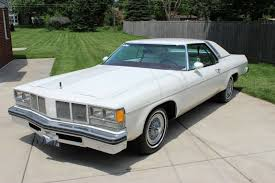 The car resembled this one.  With no A/C. The muffler was loud.  Seats were leather & sticky hot.  The back seat received only the air that came in from the front windows.  The heat on the floorboard burned. Car smelled of booze & smoke.
