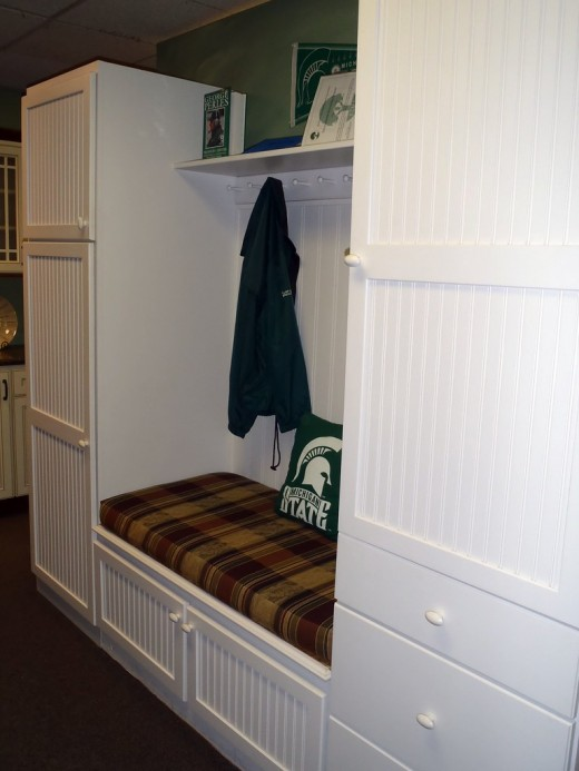 Fall mudroom decor should feel cozy and provide ample storage space for jackets and shoes.