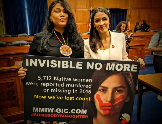 Lynette Grey Bull hold a template of the billboard image with Congresswoman Alexandria Ocasio-Cortez. Photo Courtesy of Wyoming Public Radio.