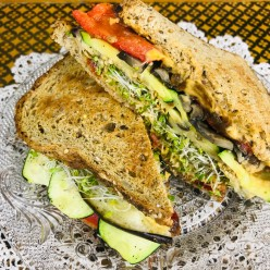 Mediterranean Roasted Vegetable Sandwich with Broccoli Sprouts and Hummus