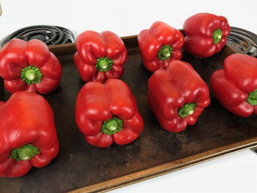 Roast the red bell peppers second because they'll take time to fully cook, and they'll need some time to cool down afterwards. It's easy to multi-task with these in the oven, so preparing the remaining ingredients at the same time is a cinch.