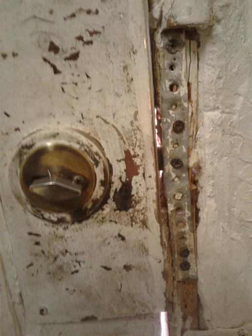 The deadbolt - and a doorjam