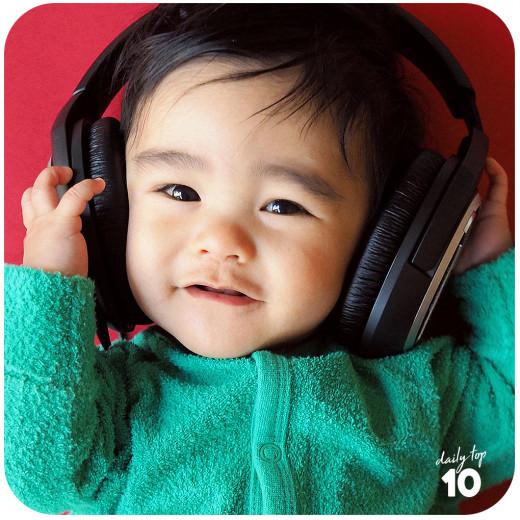 A kid enjoying music.