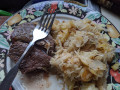 Broiled Steak and Fried Potatoes with Sauerkraut