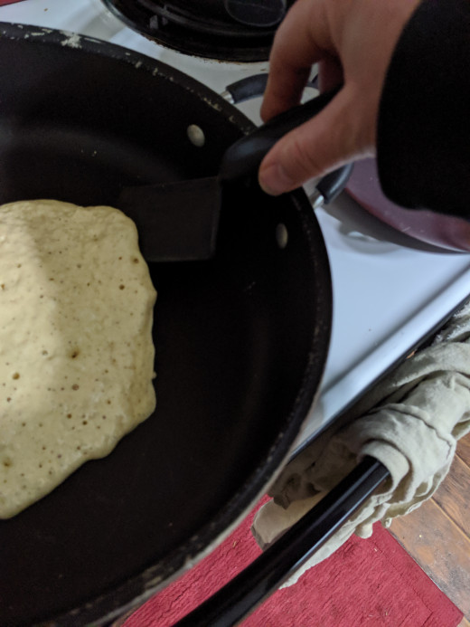 Loosen edge of pancake insert spatula under pancake, lift slightly and turn wrist, flipping pan cake over