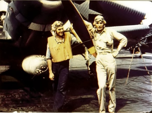 Ensign George Gay, right, poses in front of a Devastator, May 1942.
