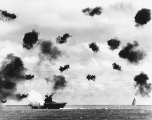 The USS Yorktown struck by a torpedo dropped by a Nakajima B5N.