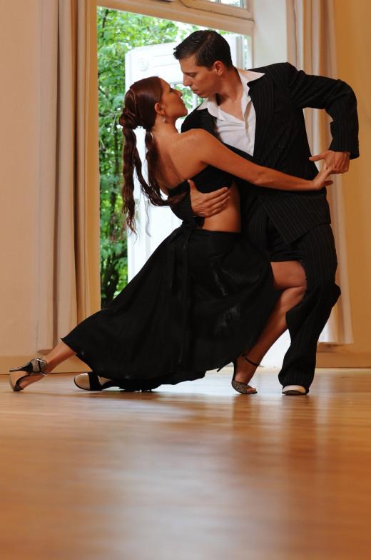 Couple dancing the tango indoors