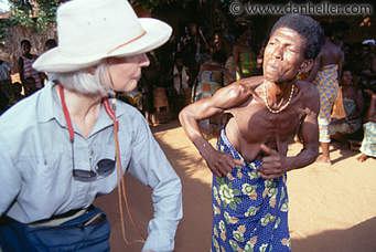 White man learning black man's dancing steps