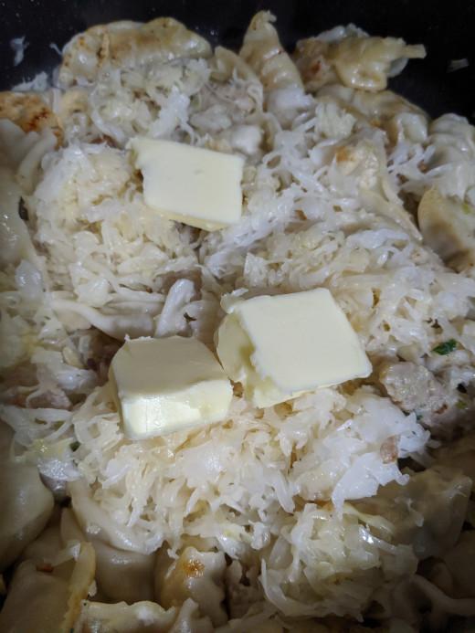 Add butter. Cook until butter melted and sauerkraut heated through.