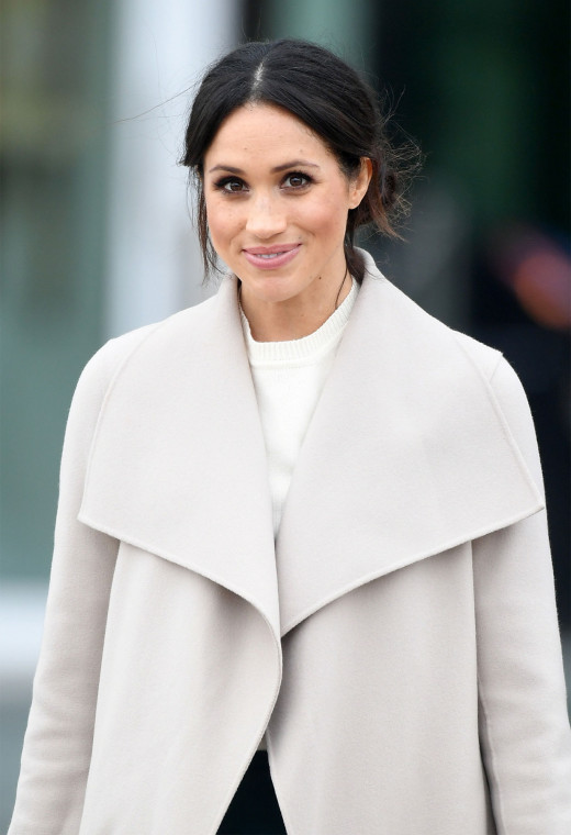 Meghan Markle poses for the cameras.