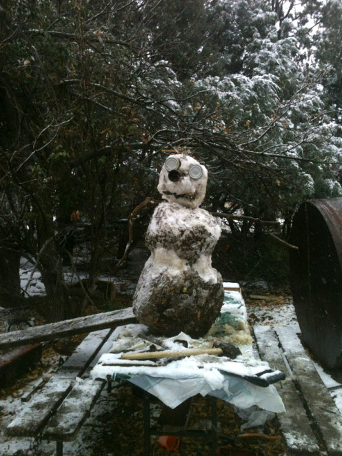 Snowmonsters are one of the children's favorite winter activities. This one was placed out of lambs' reach, and is more mud than snow. He required innovation and a flexible mindset. (Shame on the tools being covered in snow!)