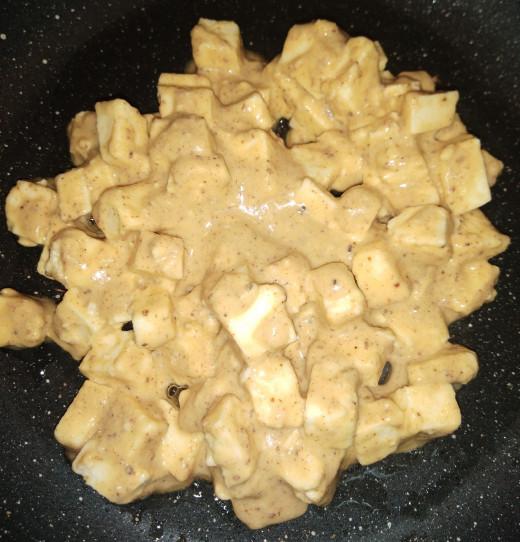 Heat 1-2 teaspoons of oil in a pan, add gram floor coated paneer.