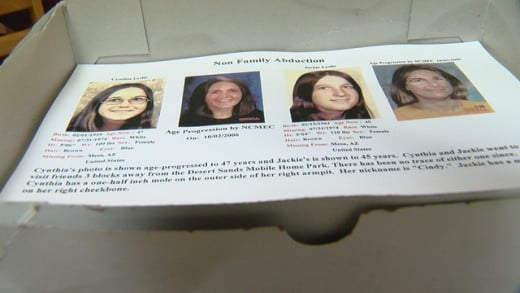 A box of age-progression fliers sits on Erma's kitchen table. Photo courtesy of KGUN.