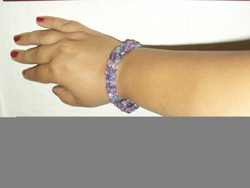 Create this simple look by placeing two multicolored bracelets together.