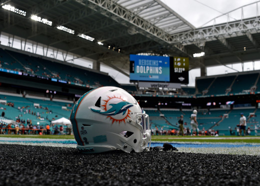 A Miami Dolphins helmet is seen on the field before a 2019 game against the Washington Redskins at Hard Rock Stadium.