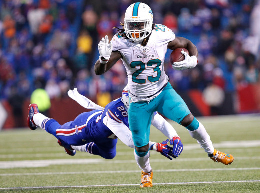 Miami Dolphins running back, Jay Ajayi (23), eludes a tackle during the second half at New Era Field in a 2016 overtime loss to the Buffalo Bills. Ajayi is the last Miami Dolphins player to rush for 1,000 yards in a season.